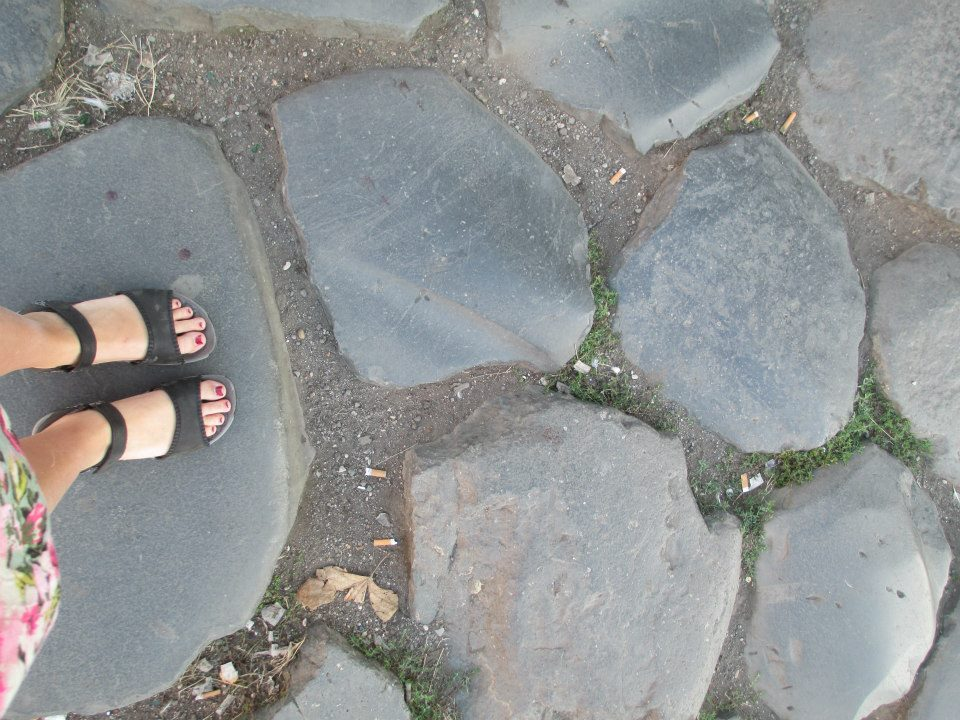 feet on rocks as viewed from above
