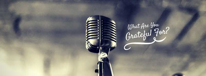 old timey microphone with text overlay: what are you grateful for?
